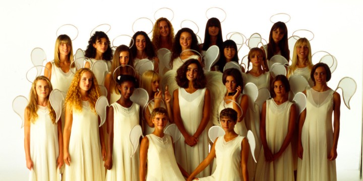 "All dressed in long white robes and with stylized wings, the young girls from ""Non è la RAI"" make an angelic choir, leaving some space for the hostess and leader of the broadcast, Ambra Angiolini on 1994 in Italy."